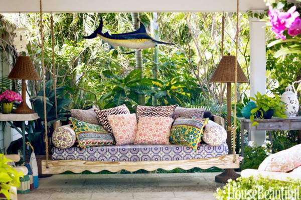 Textiles that can easily be moved indoors for winter bring this space alive for warmer weather.